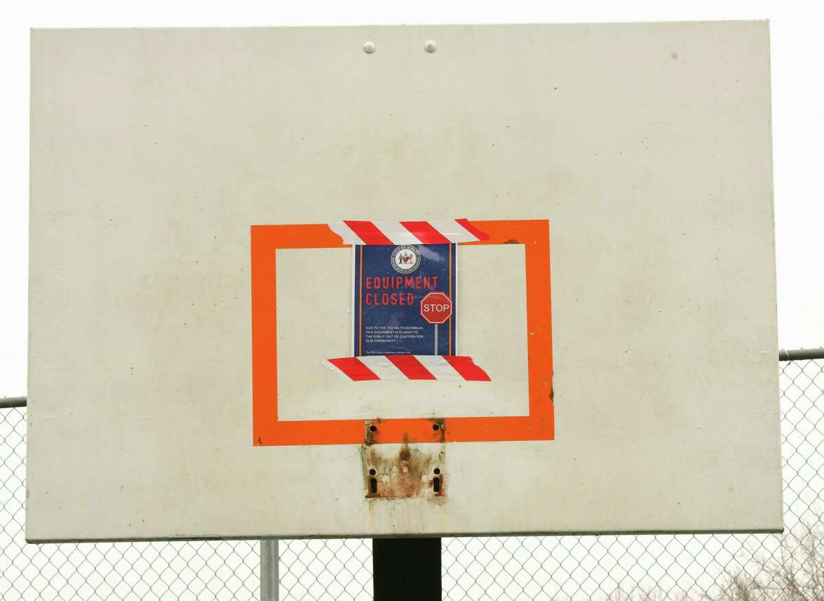 A basketball backboard is seen without a hoop and net on a basketball court in a park along Woodlawn Ave. on Wednesday, April 8, 2020 in Albany, N.Y. The hoop and net were apparently taken down due to people not abiding by the social distancing mandate. (Lori Van Buren/Times Union)
