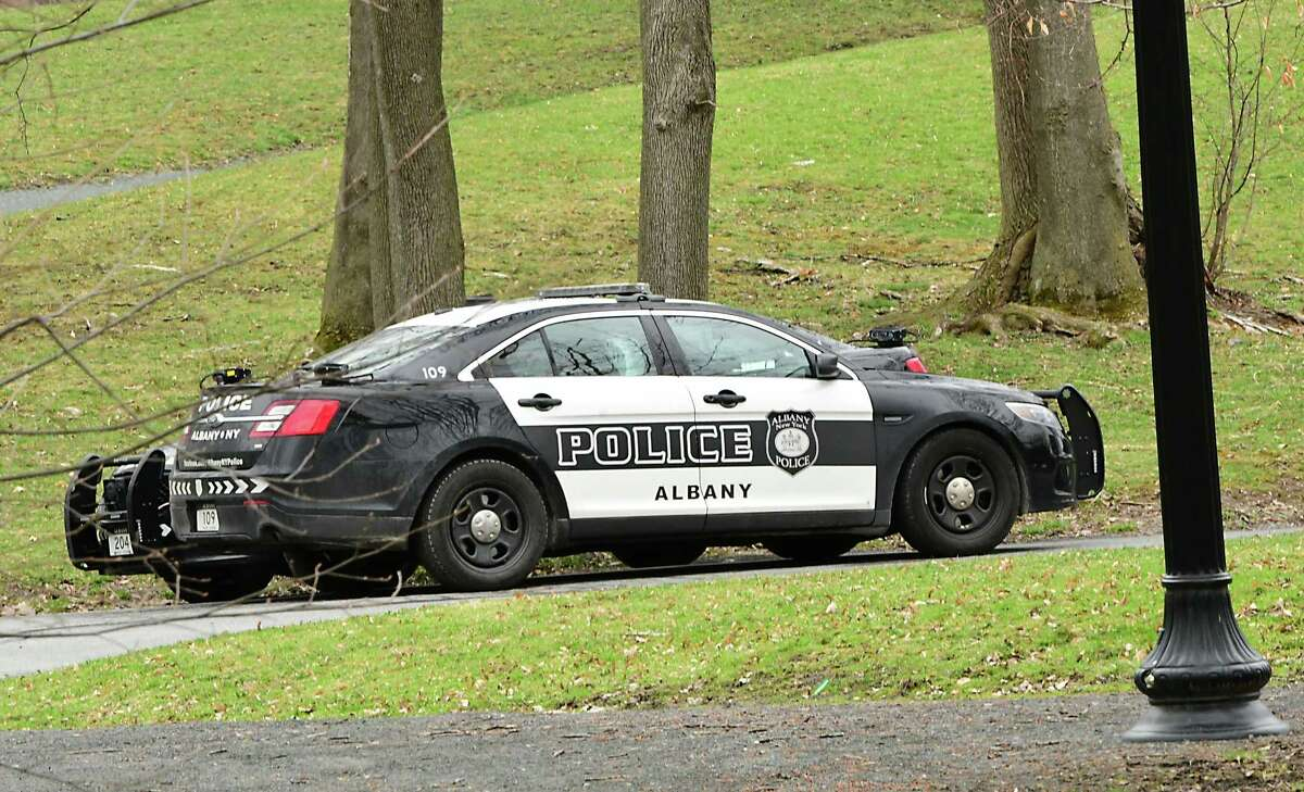 A couple of Albany Police Department patrol cars are seen parked next to each other in Washington Park on Wednesday, April 8, 2020 in Albany, N.Y. (Lori Van Buren/Times Union)