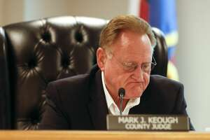 Montgomery County Judge Mark Keough takes a moment as he talks about the need to extend the countyÕs disaster declaration during an emergency Montgomery County Commissioners Court meeting, Wednesday, April 8, 2020, in Conroe. The court voted to extend the countyÕs disaster declaration to May 11.