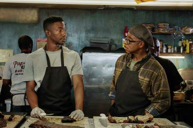 """Mamoudou Athie and Courtney B. Vance in a scerne from """"Uncorked."""""""