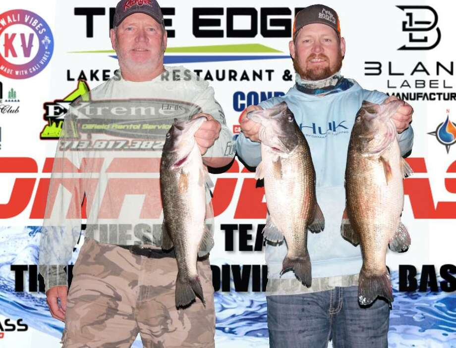 Tim and Evan Carlson won the CONROEBASS Tuesday night tournament with a stringer weight of 18.98 pounds. Photo: CONROEBASS