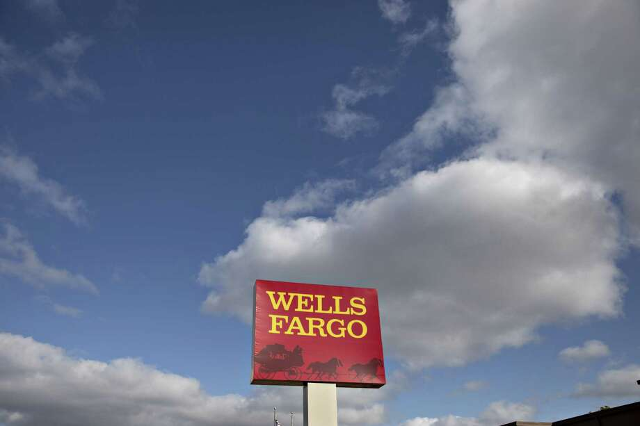 Signage is displayed outside a Wells Fargo & Co. bank branch in Rock Island, Illinois. Photo: Bloomberg Photo By Daniel Acker / © 2019 Bloomberg Finance LP