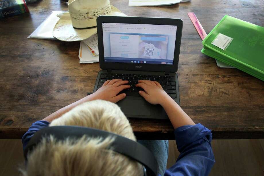 A child does schoolwork at his family home Photo: Getty Images / 2020 Getty Images
