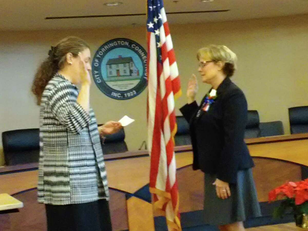 Torrington Mayor Elinor Carbone, right, takes the oath of office and is sworn in by attorney Jaime LaMere at City Hall. LaMere was recently named personnel director for the city.
