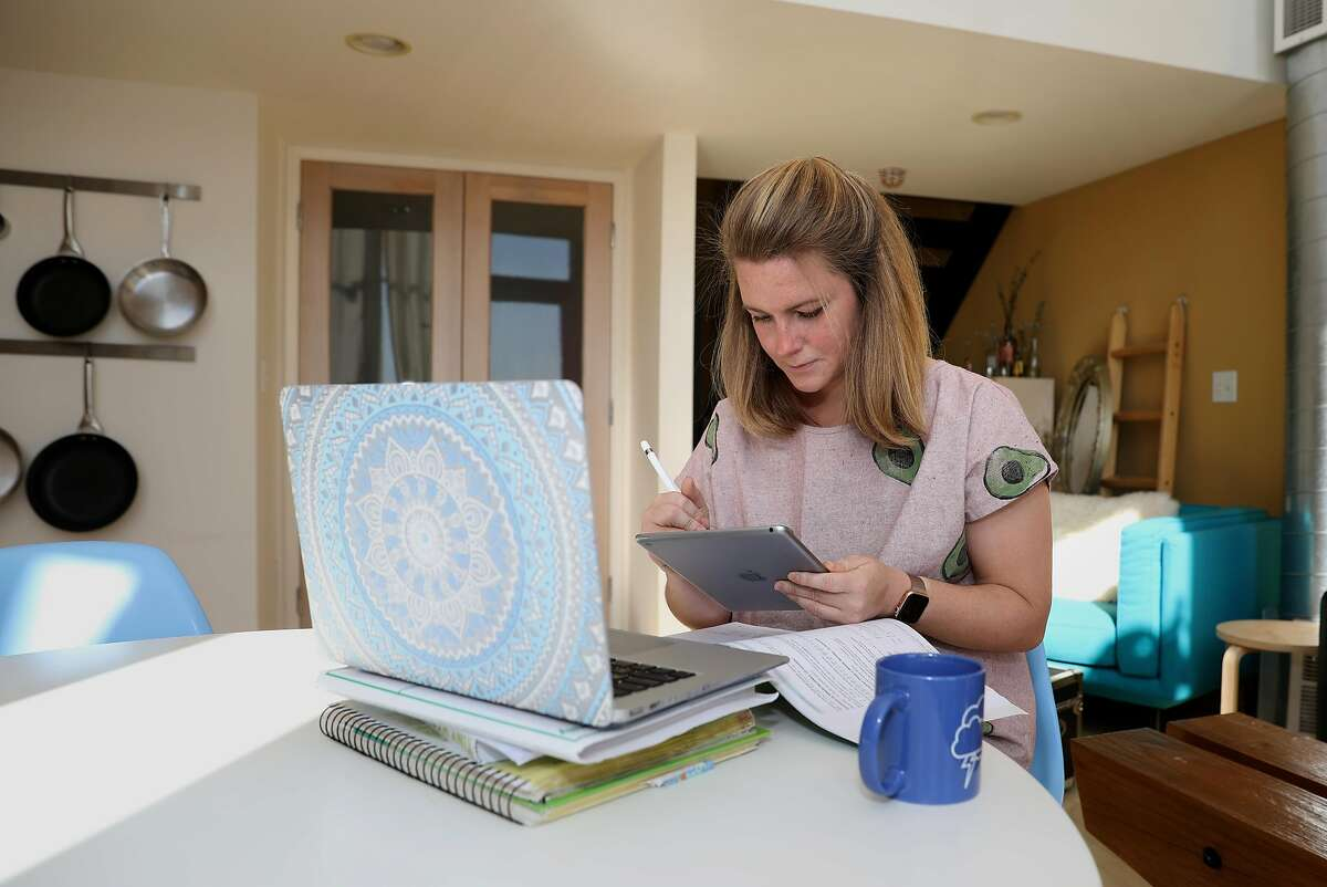 Emily Storms gets ready to tutor her fifth grade math class at home via Zoom this morning on Tuesday, April 7, 2020, in San Francisco, Calif.