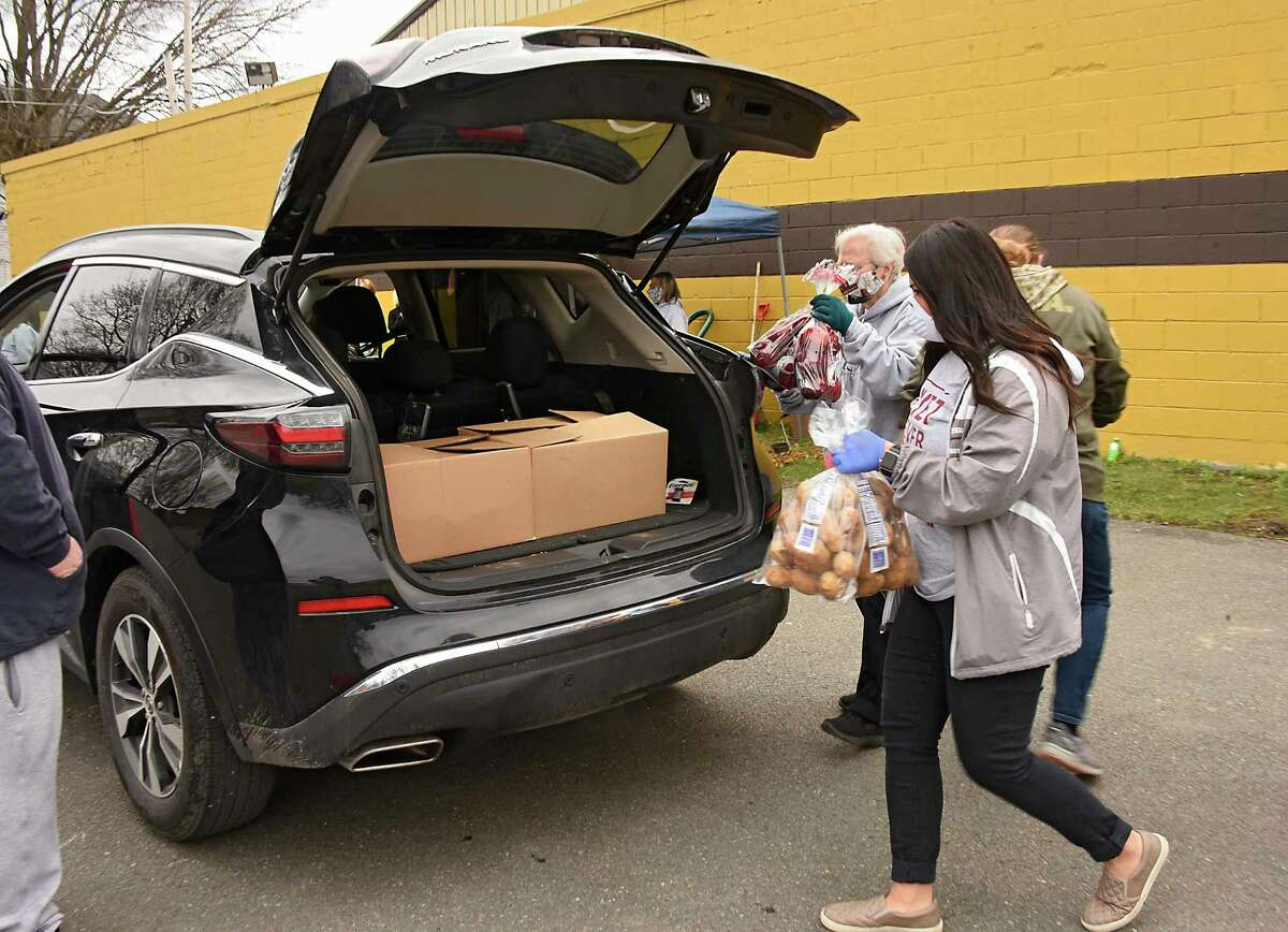 Volunteers at the Dome load food from the Regional Food Bank into the cars of people affected due to closures because of coronavirus pandemic on Wednesday, April 8, 2020 in Watervliet, N.Y. (Lori Van Buren/Times Union)