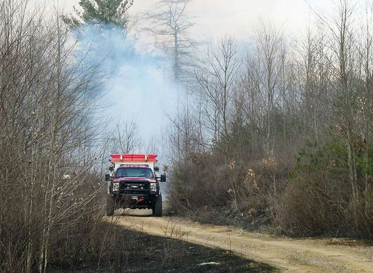 Thirteen fire departments, including Haddam Volunteer Fire Co., helped extinguish a 10-acre brush fire Tuesday near the Babcock Pond Wildlife Management Area in East Haddam.