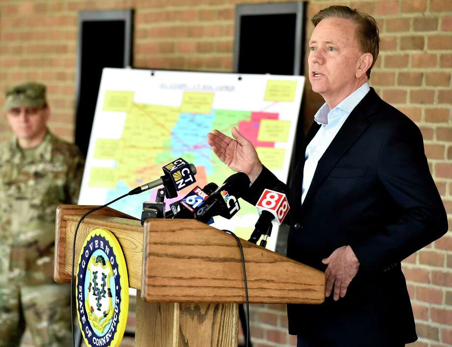 New Haven, Connecticut - Wednesday, April 01, 2020: Connecticut Governor Ned Lamont, right, holds a press conference after a tour of the Federal Emergency Management Agency 250-bed medical field hospital Wednesday for non-coronavirus patients staged in the Southern Connecticut State University Moore Field House in New Haven by 75 members of the Connecticut National Guard's 1-102nd Infantry. The site is intended to treat non-COVID-19 patients so there will be more hospital beds people who are impacted by COVID-19 / Coronavirus. Photo: Peter Hvizdak / Hearst Connecticut Media / New Haven Register