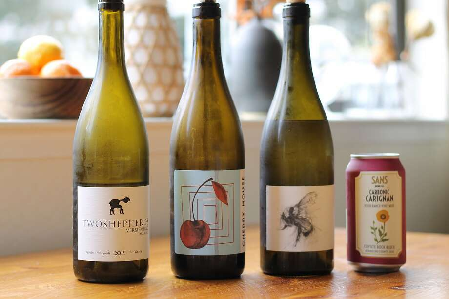 Some of my favorite wines from this past week of coronavirus quarantine (and no, these bottles aren't full). From left: Two Shepherds Vermentino, Cherry House Red, Big Table Farm Wild Bee Chardonnay and Sans Carbonic Carignan. Photo: Esther Mobley / The Chronicle