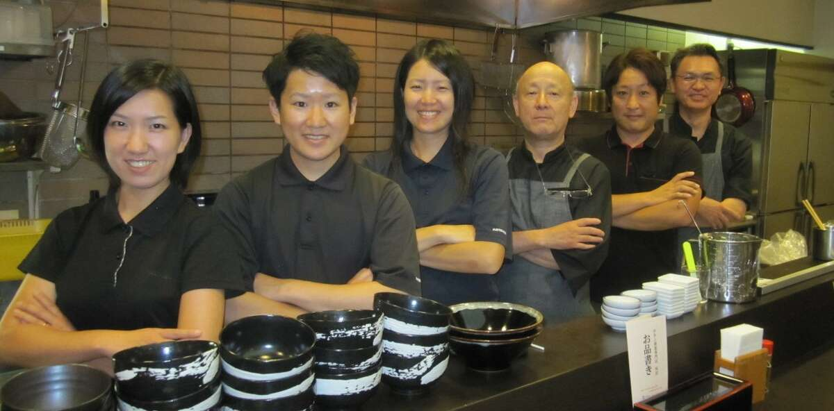 Masayuki Tadokoro (second from right) stands with his family's restaurant's team in Japan. Tadokoro opened his first U.S. restaurant, Curry Hyuga in Burlingame, with Noriaki Kojima during the coronavirus.