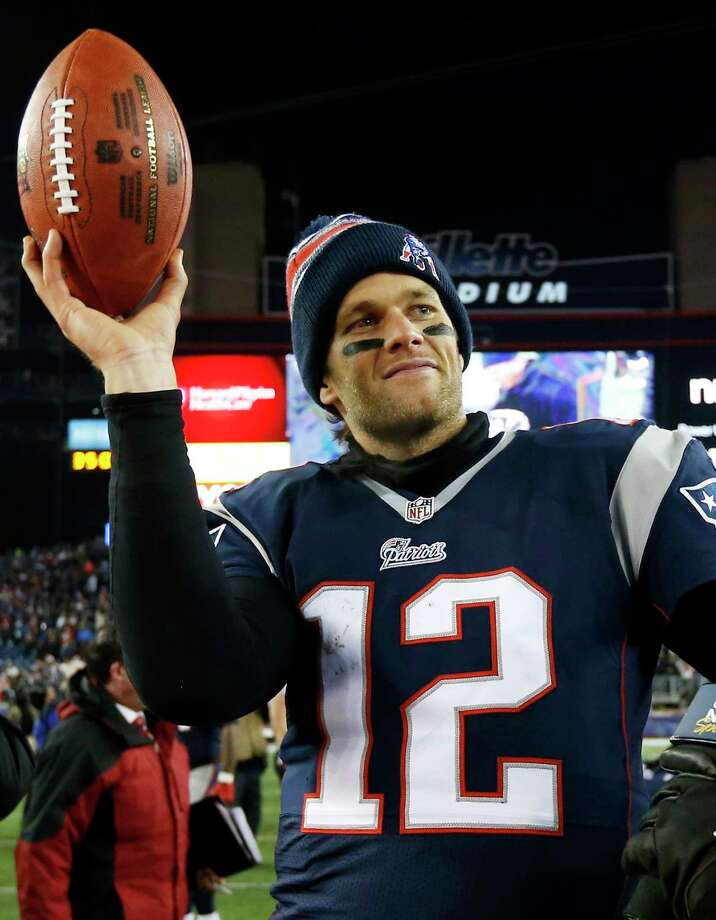 FILE - In this Jan. 10, 2015, file photo, New England Patriots quarterback Tom Brady holds up the game ball after an NFL divisional playoff football game against the Baltimore Ravens in Foxborough, Mass. Brady was selected to the 2010s NFL All-Decade Team announced Monday, April 6, 2020, by the NFL and the Pro Football Hall of Fame. (AP Photo/Elise Amendola, File) / Copyright 2020 The Associated Press. All rights reserved.