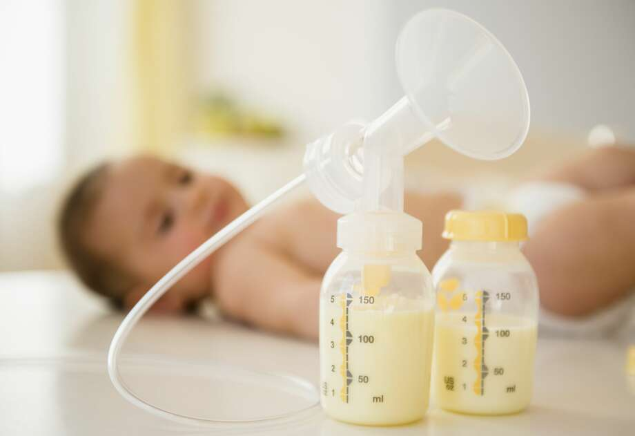 Breast pump next to baby - stock photo Photo: Jamie Grill/Getty Images / Jamie Grill Photography