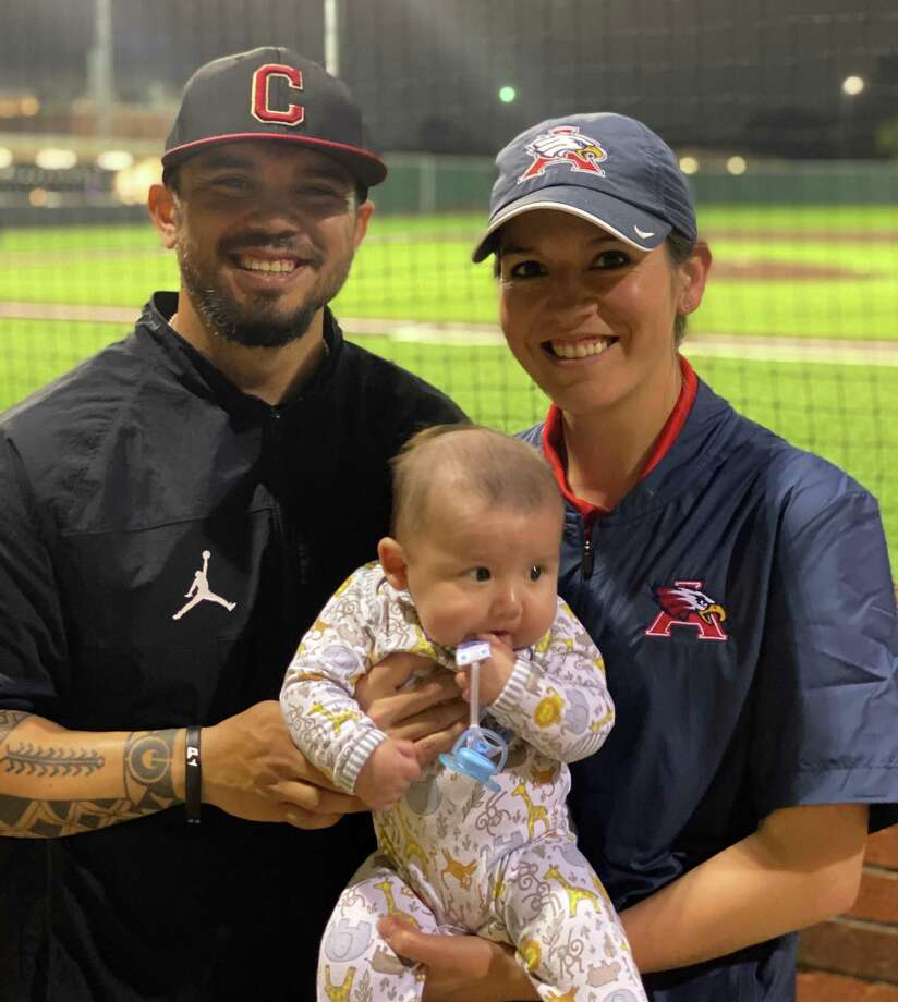 Caney Creek baseball coach Kristopher Carroll poses for a photo with his wife Alyssa, who is an assistant softball coach at Atascocita, and their son Kristopher Jr. 'KJ'. Photo: Photo Submitted
