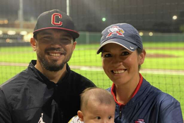 Caney Creek baseball coach Kristopher Carroll poses for a photo with his wife Alyssa, who is an assistant softball coach at Atascocita, and their son Kristopher Jr. 'KJ'.