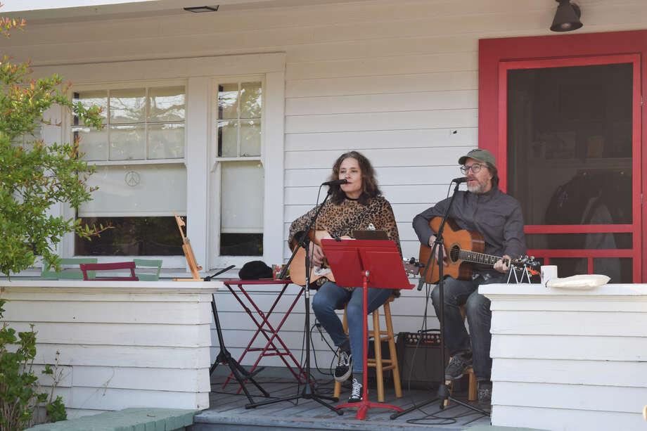 Alameda musicians Deborah Crooks and Kwame Copeland play acoustic folk-rock on their porch for neighbors every Friday night. Photo: Grant Kalasky