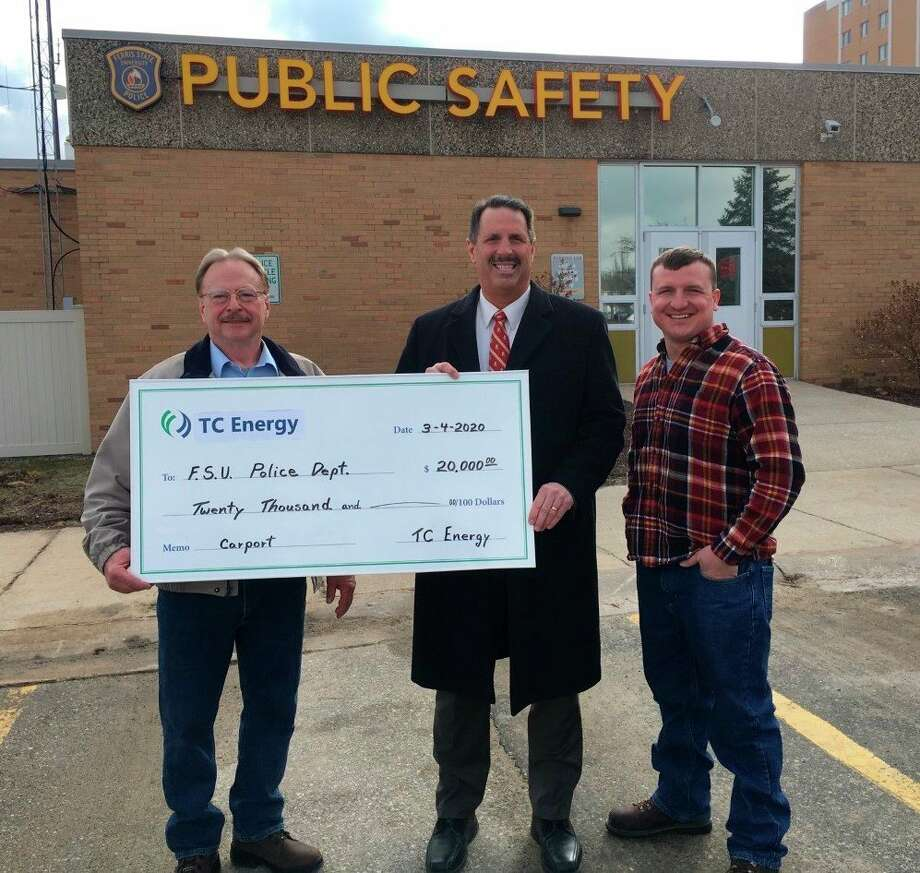 Ferris State University Department of Public Safety chief of police Bruce Borkovich (middle) accepted a $20,000 grant from representatives with TC Energy this year. He said the funds will be used to construct a carport for the department's patrol vehicles. (Courtesy photo)