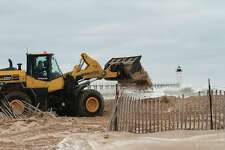 In late March,Manistee Department of Public Works (DPW) staffcreated a berm out of sand, as 25 mph winds pounded in from the west creating flooding near Fifth Avenue Beach. This weekthe department implemented a new staff scheduling system to protect employees during the coronavirus pandemic.(File photo)