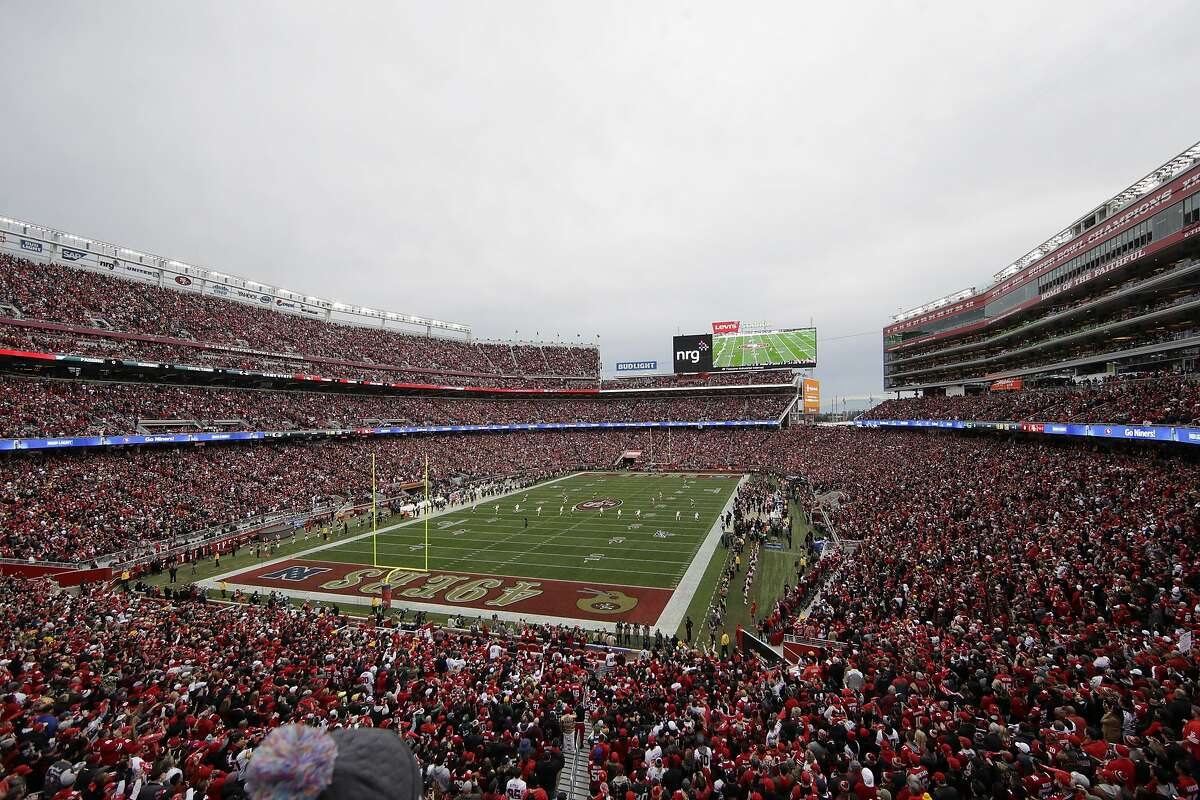 FILE - In this Jan. 19, 2020, file photo, fans at Levi's Stadium watch as the Green Bay Packers kickoff to the San Francisco 49ers during the first half of the NFL NFC Championship football game in Santa Clara, Calif. (AP Photo/Jeff Chiu, File)