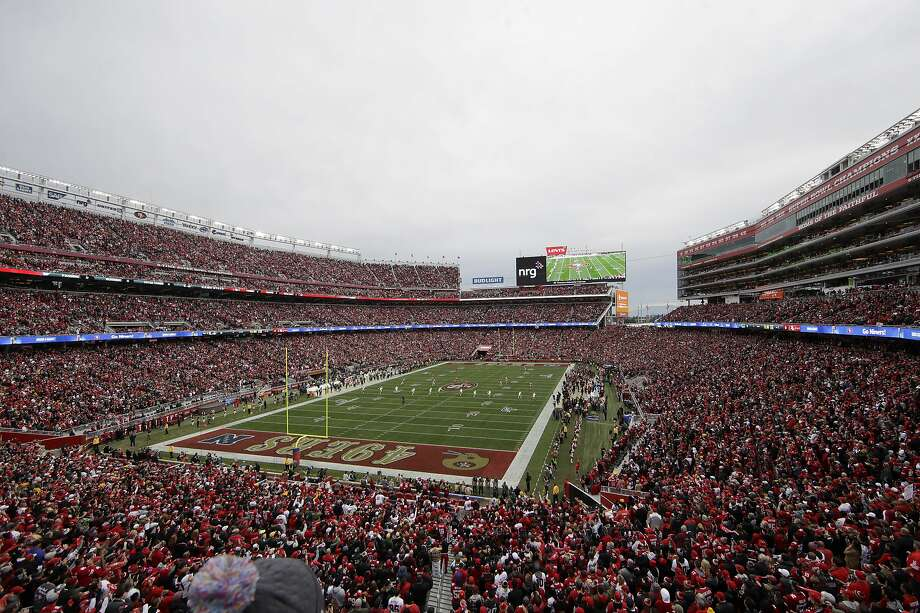 FILE - In this Jan. 19, 2020, file photo, fans at Levi's Stadium watch as the Green Bay Packers kickoff to the San Francisco 49ers during the first half of the NFL NFC Championship football game in Santa Clara, Calif. At a time when America is trying to cope with the financial fallout created by the deadly coronavirus, the renewal of NFL season tickets is not exactly a high priority in the midst of soaring unemployment, business closures and a volatile stock market. Most teams understand this, and have acted accordingly. (AP Photo/Jeff Chiu, File) Photo: Jeff Chiu, Associated Press