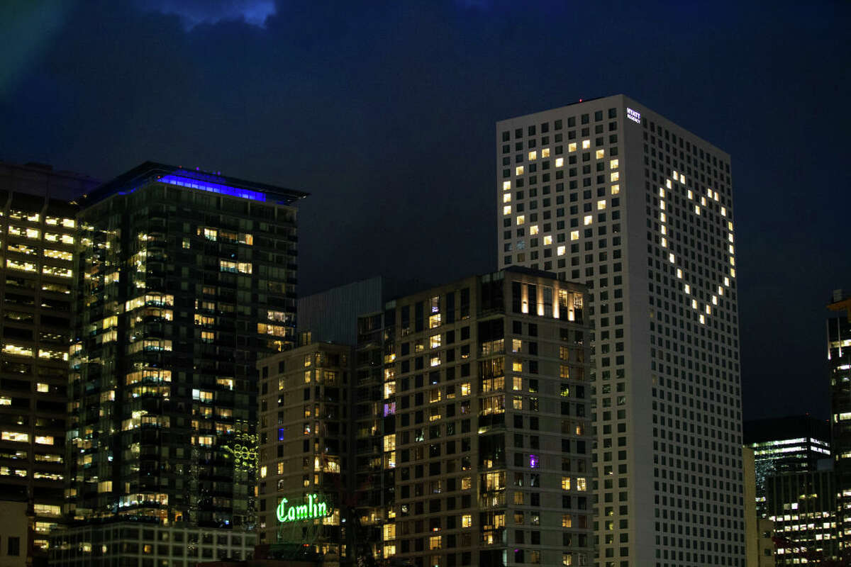The Hyatt Regency has strategically lit up rooms to create a heart in Seattle, Washington. Click through the gallery to see street art, teddy bears and messages of hope displayed throughout Seattle during the COVID-19 pandemic.