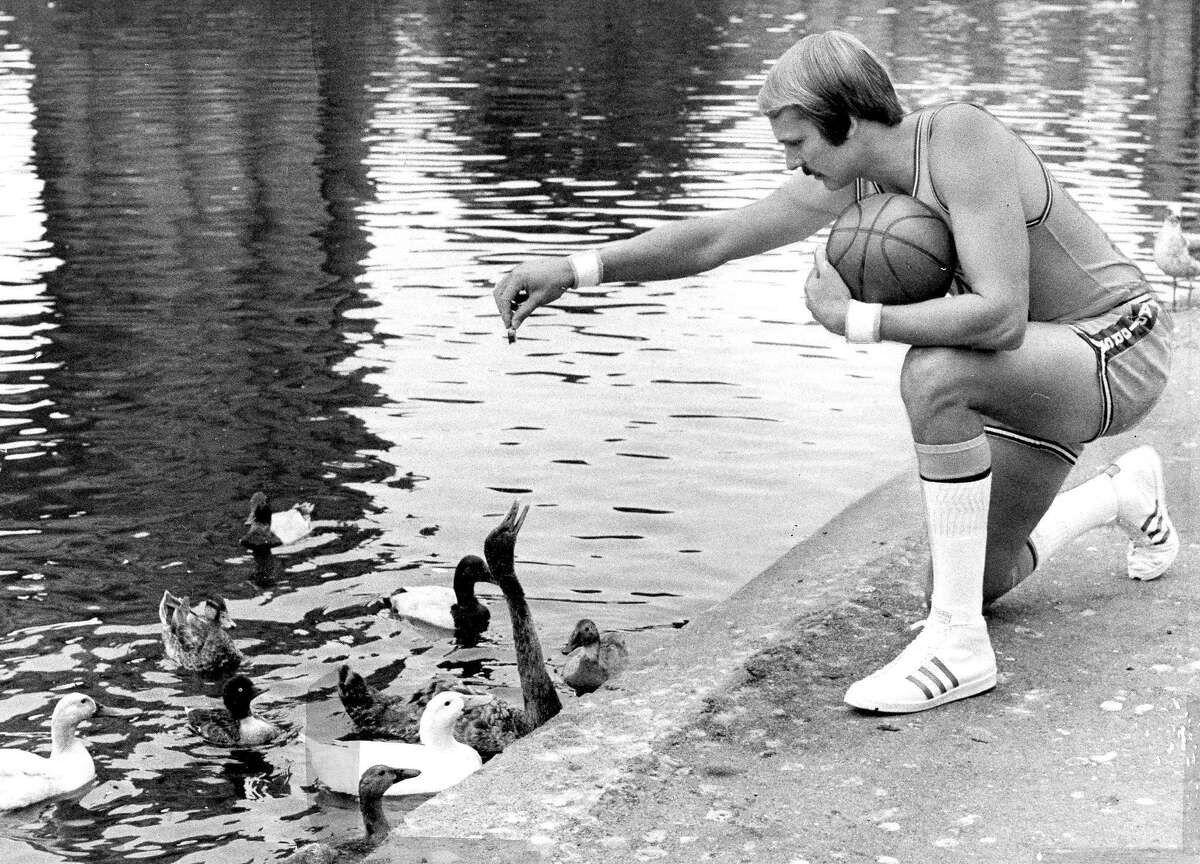 Warriors great Rick Barry feeds the ducks at the Palace of Fine Arts in San Francisco. Sept. 11, 1973.