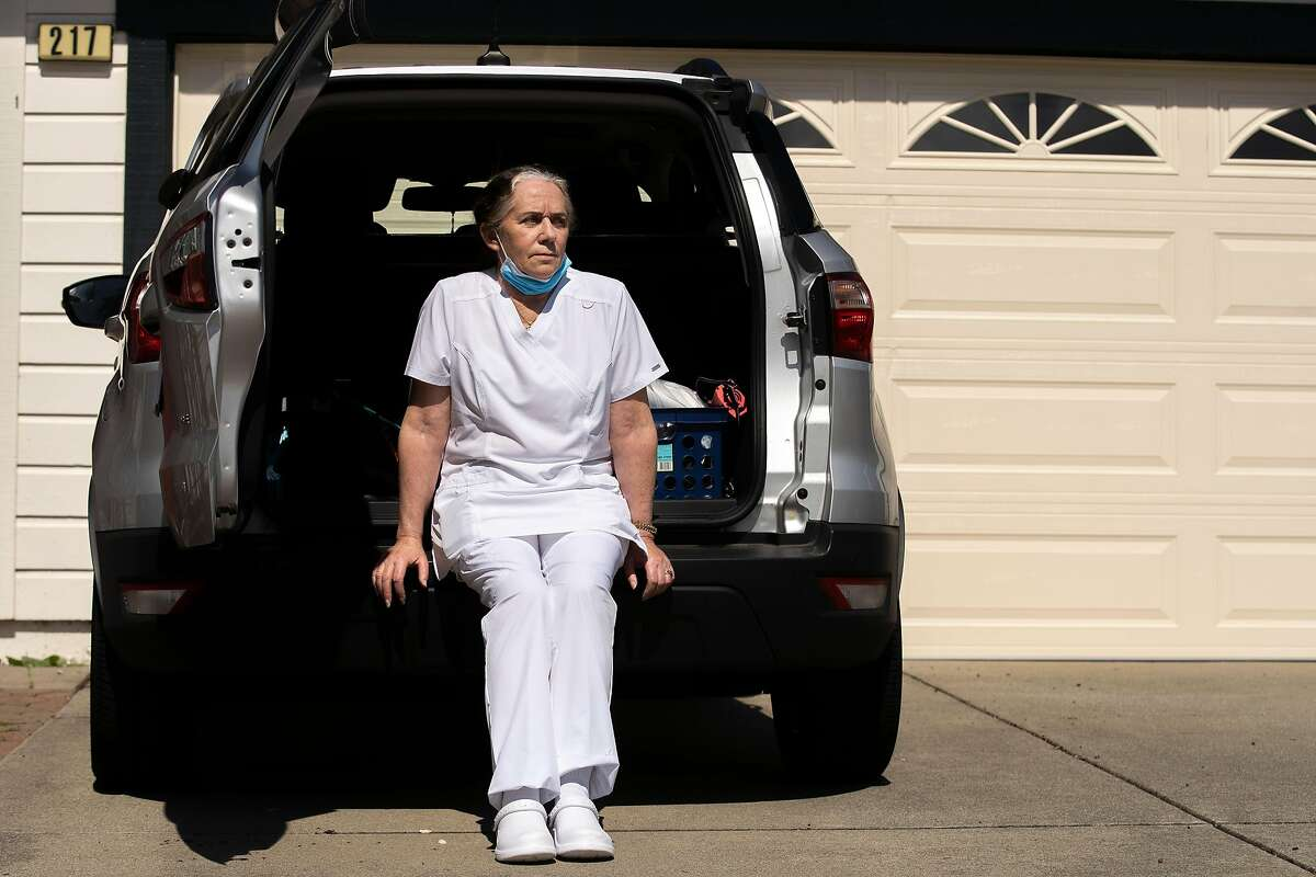 A portrait of Wendy Barnicoat outside her home on Tuesday, April 7, 2020, in Pacifica, Calif. Barnicoat, a phlebotomist for Sanguine Biosciences, came home after drawing blood from a patient who recovered from COVID-19. The blood sample will be used for research.