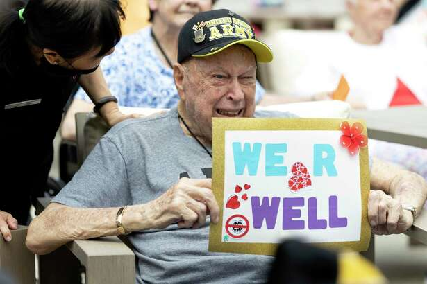 Avanti Senior Living resident, Roger Hoestenbach, bursts into tears as he sees his family during the Senior Living Parade, Tuesday, April 7, 2020. Avanti Senior Living at Towne Lake believed the parade would boost morale for it's residents during the COVID-19 pandemic.