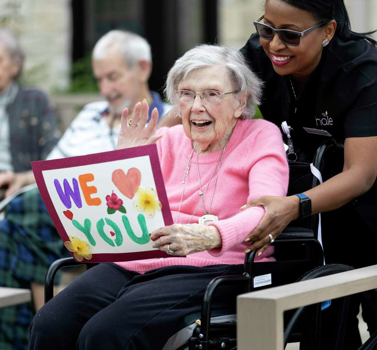 Southern Knights Assisted Living in Tomball is hosting a parade on May 29. Here, Shirley Brown, with the assistance of a Avanti Senior Living employee, waves at family members during the Senior Living Parade in Cypress, Tuesday, April 7, 2020. Residents were able to see their family while practicing social distancing in compliance with CDC recommendations.