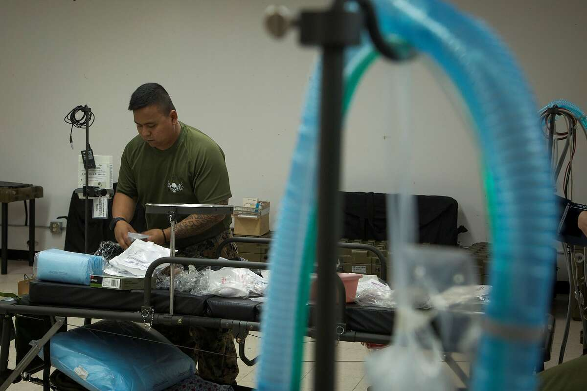200405-M-RB959-0134 NAVAL BASE GUAM, (April 5, 2020) Hospital Corpsman 3rd Class Adan Trinidad, an intensive care unit medic with 3rd Medical Battalion, 3rd Marine Logistics Group, prepares an intensive care unit bed as part of transitioning an empty building into an operationally capable ICU, in order to provide medical support to any USS Theodore Roosevelt (CVN 71) Sailors in need at Naval Base Guam, Guam, April 5, 2020. As the nation's force-in-readiness, the military has a variety of capabilities which, upon request, may be used to support the whole-of-government effort in response to the COVID-19 pandemic. (U.S. Marine Corps photo by Staff Sgt. Jordan E. Gilbert/Released)