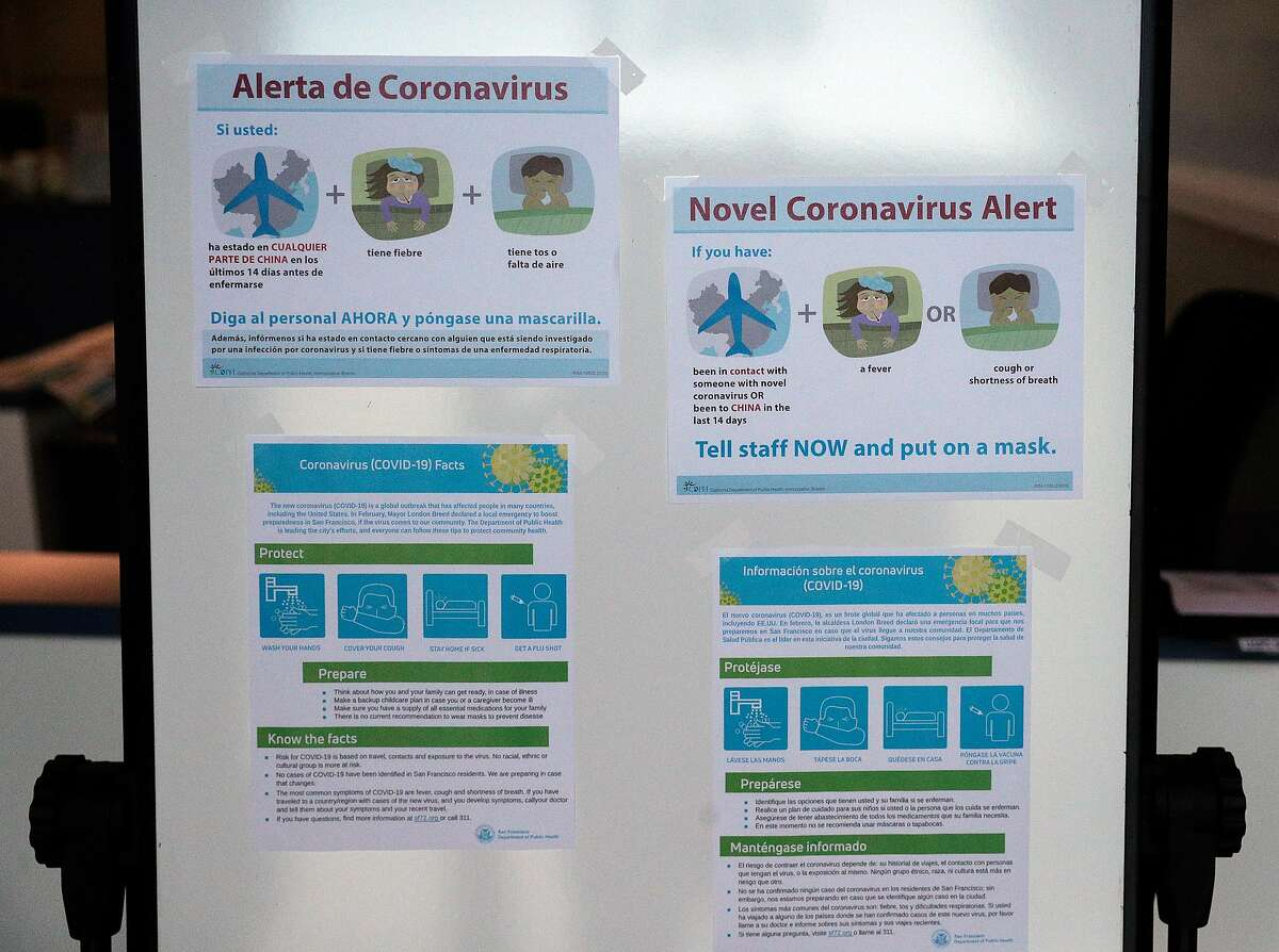 Sign board with Coronavirus posters in english and spanish at La Casa De Las Madres in San Francisco, Calif., on Tuesday, April 7, 2020. The shelter in place order appears to be leading to an increase in domestic violence cases even though calls are not up drastically since some victims and survivors are even more afraid or unable to call or text for help.