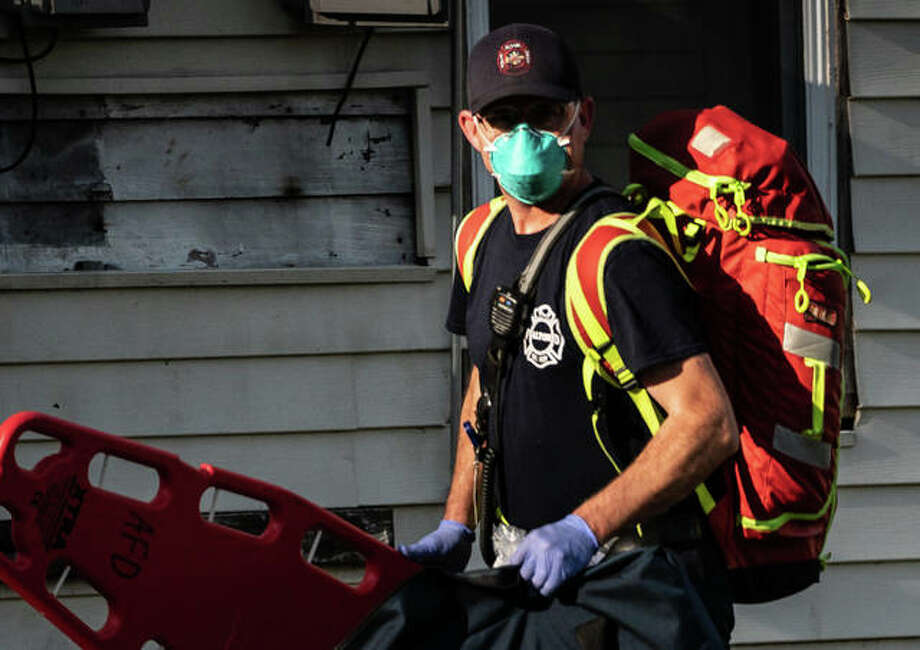 An Alton paramedic works a scene unrelated to the second reported coronavirus death in Madison County. Photo: Nathan Woodside | The Telegraph