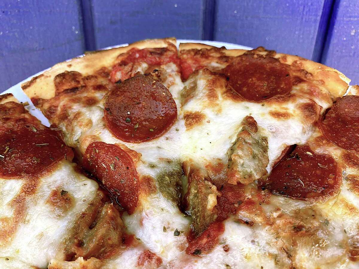 The Sly Stallone pizza comes with pepperoni, meatball and sausage at Cerroni's Purple Garlic on Austin Highway.