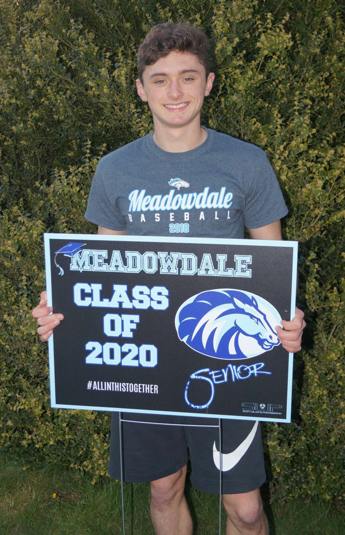Meadowdale High School senior, Mason Vaughn poses with a yard sign celebrating the class of 2020. Photo courtesy of Amy Vaughn.