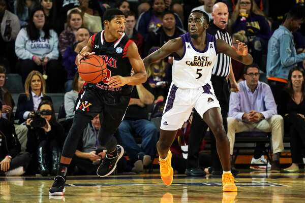 GREENVILLE, NC - NOVEMBER 05: East Carolina Pirates guard Logan Curtis (5) gourds Virginia Military Keydets guard Travis Evee (3) during a game between the East Carolina Pirates and the Virginia Military Institute Keydets on November 5, 2019 at Williams Arena at Minges Coliseum in Greenville, NC. (Photo by Greg Thompson/Icon Sportswire via Getty Images)