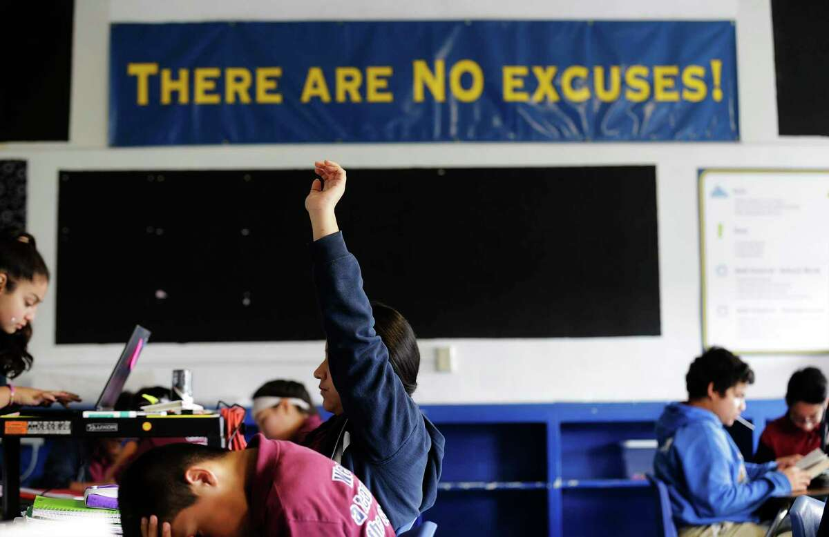 A seventh grade reading class in the KIPP Aspire Academy in 2015. KIPP Public Schools announced Wednesday that its buildings statewide would remain shuttered for the rest of the semester amid the coronavirus outbreak. (Kin Man Hui/San Antonio Express-News)