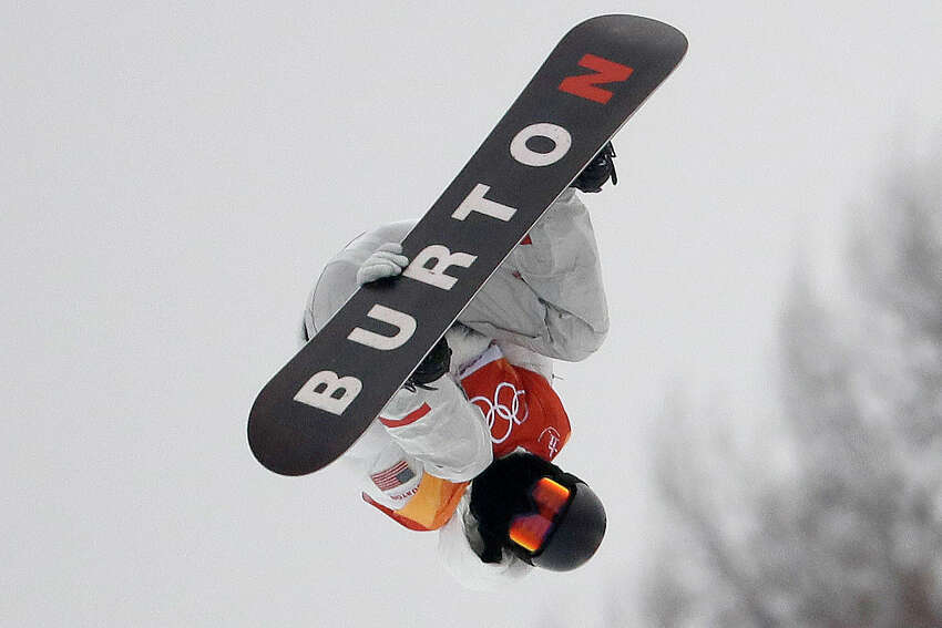FILE - In this Feb. 14, 2018, file photo, Shaun White, of the United States, jumps during the men's halfpipe finals at the 2018 Winter Olympics in Pyeongchang, South Korea. The Burton snowboard company is donating 500,000 respirator masks to hospitals across the Northeast, harnessing the company's worldwide footprint to help put a dent in the country's lagging stockpile of personal protective equipment for the coronavirus pandemic. (AP Photo/Lee Jin-man, File)