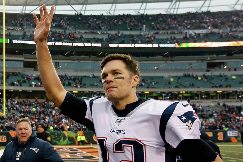FILE - In this Dec. 15, 2019, file photo, New England Patriots quarterback Tom Brady waves to the crowd after an NFL football game against the Cincinnati Bengals in Cincinnati. The Miami Dolphins signed seven potential starters, but none will help their chances of overtaking the New England Patriots in the AFC East as much as Tom Brady did by bolting from Boston for Tampa Bay. (AP Photo/Frank Victores, File)