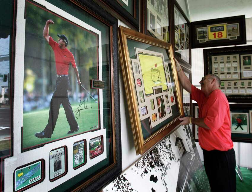 FILE - In this April 8, 2010, file photo, vendor Roger E. Gilchrist hangs memorabilia for sale in his tent outside the gates of the Augusta National Golf Club, the site of the Masters golf tournament in Augusta, Ga. The Masters is so intertwined with Augusta, they added an extra day to spring break. You see, the first full week of April isn't just a blip in time for this place. It's their identity, their way of life, their golf-cart path to success. (AP Photo/Rob Carr, File)