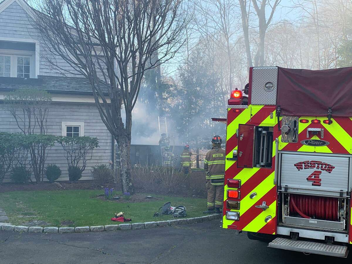 Weston, Conn., firefighters on scene for a dumpster fire on Tuesday, April 7, 2020.