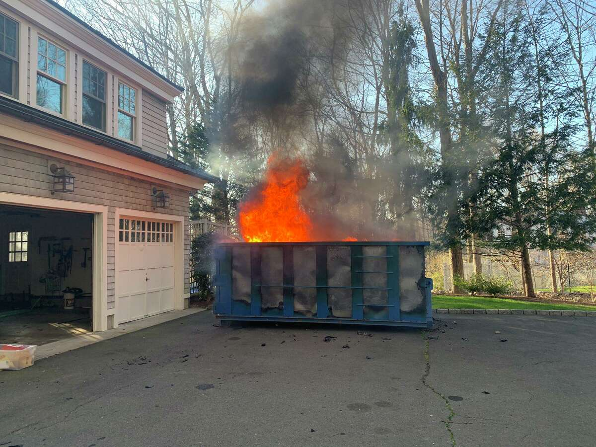 A dumpster fire in Weston, Conn., on Tuesday, April 7, 2020.