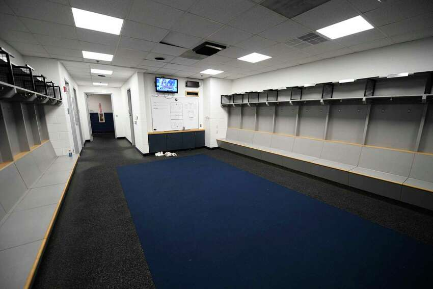 The empty visitors NHL hockey locker room is seen at Capital One Arena in Washington, Thursday, March 12, 2020. The Washington Capitals were to play the Detroit Red Wings later tonight. The NHL is following the NBAa€™s lead and suspending its season because of the coronavirus pandemic. NHL Commissioner Gary Bettman announced Thursday it is pausing its season, one day after the NBA suspended play after a player tested positive Wednesday for COVID-19.(AP Photo/Nick Wass)