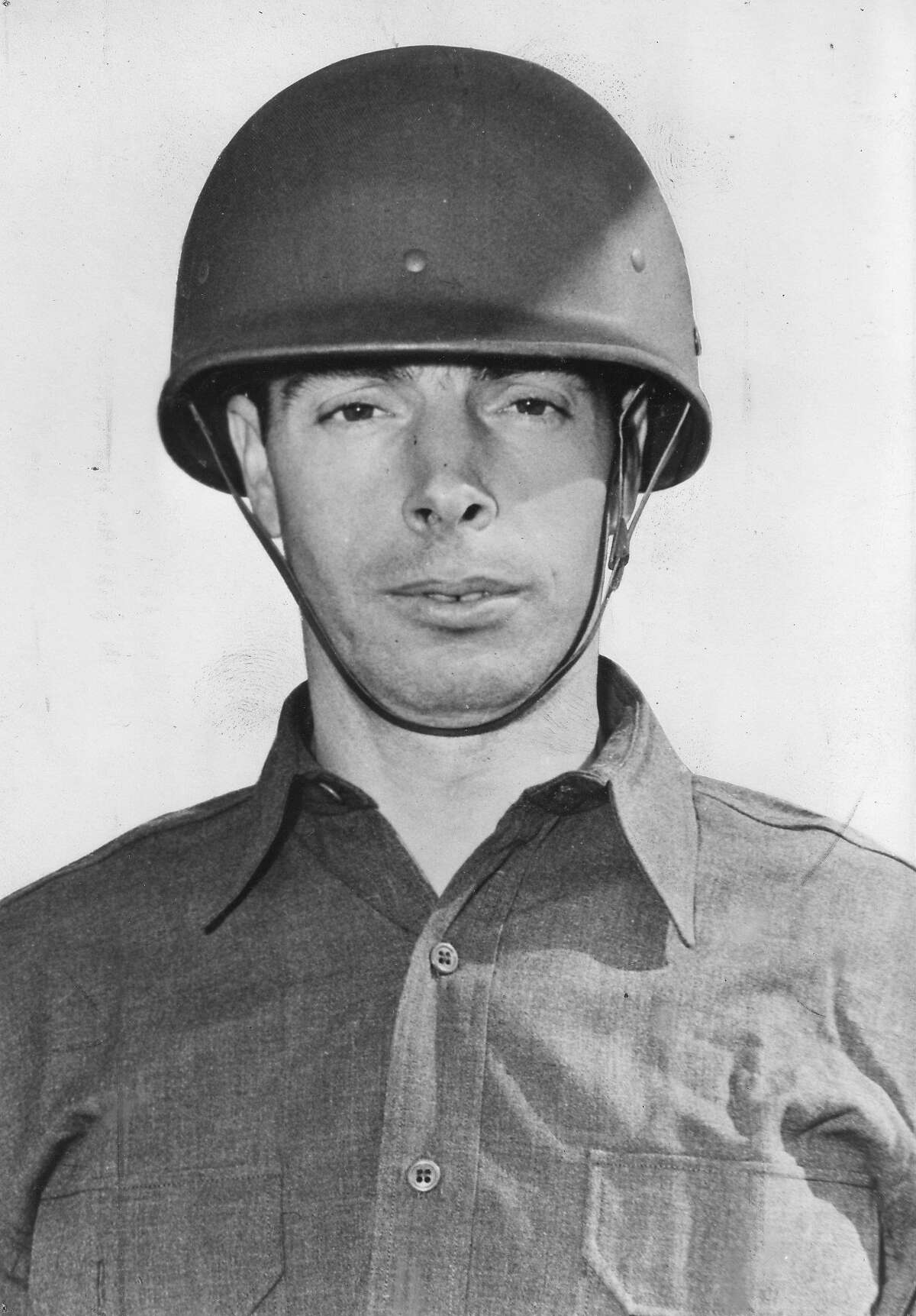 Close-up of American US Army private and baseball player Joe DiMaggio (1914 - 1999), 1943. ~~