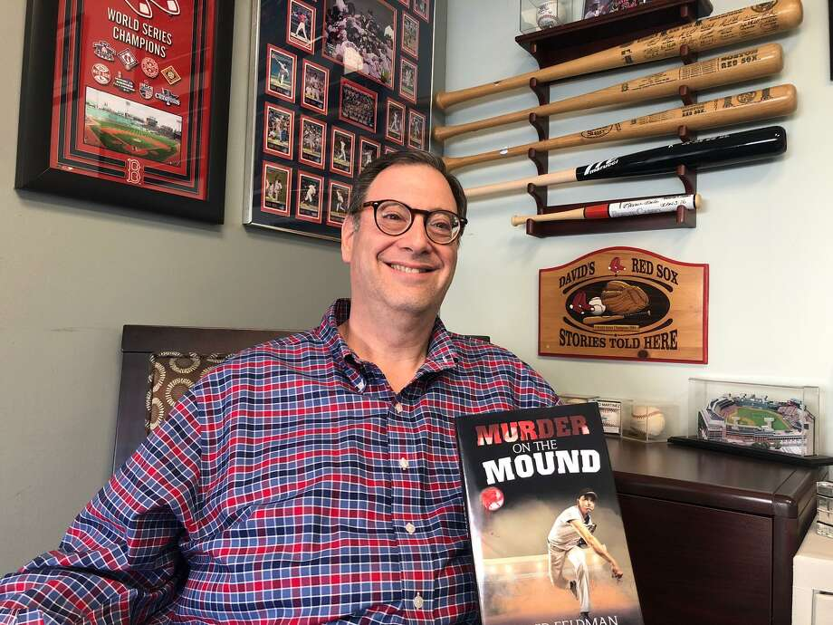 "Boston Red Sox fanatic David Feldman shows off his new novel, ""Murder on the Mound."" Photo: Brian Gioiele / Hearst Connecticut Media / Connecticut Post"