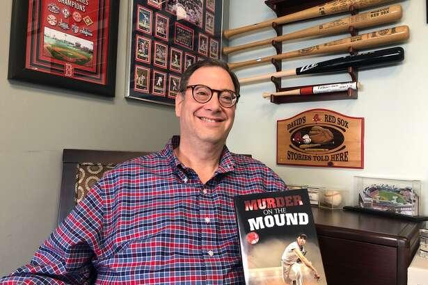 "Boston Red Sox fanatic David Feldman shows off his new novel, ""Murder on the Mound."""