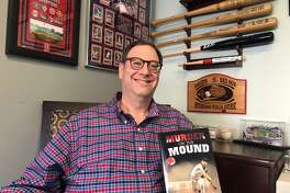"Boston Red Sox fanatic David Feldman shows off his new novel, ""Murder on the Mound."""
