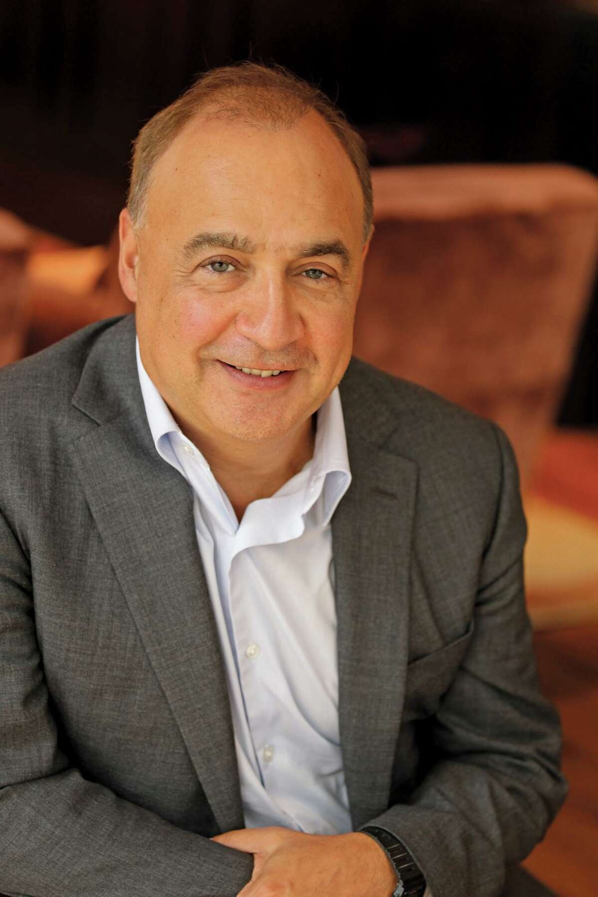 Len Blavatnik, a Ukraine-born business executive is worth more than $18 billion according to Forbes, through his holding company, Access Industries.