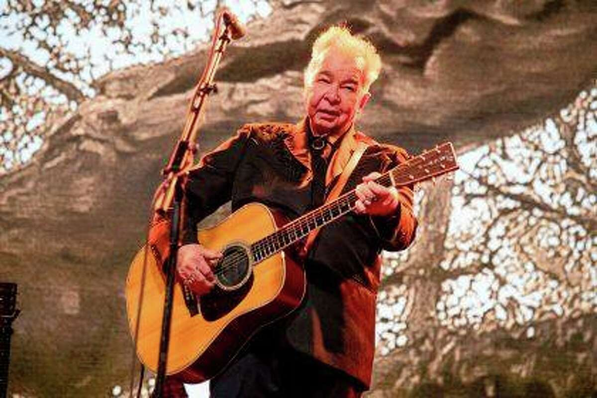 John Prine performs June 15 at the Bonnaroo Music and Arts Festival in Manchester, Tennessee. Prine, 73, died Tuesday from complications of the coronavirus.