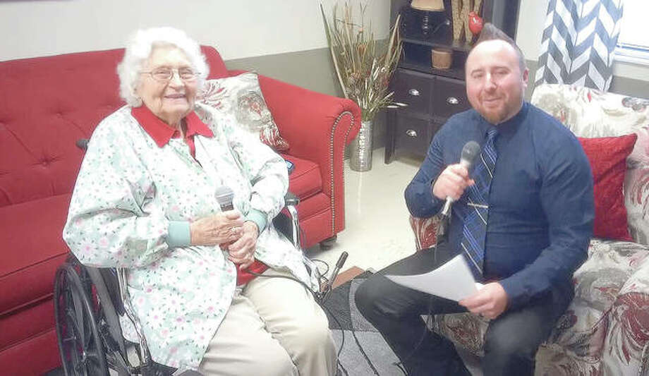 White Hall Nursing and Rehabilitation Center resident Frances Bridgewater is interviewed by Scott Phares, the nursing facility's director of admissions and sales, for a video to be posted to Facebook. Phares has been publishing interviews with residents on the Facebook page of his podcast — The SJP Show.