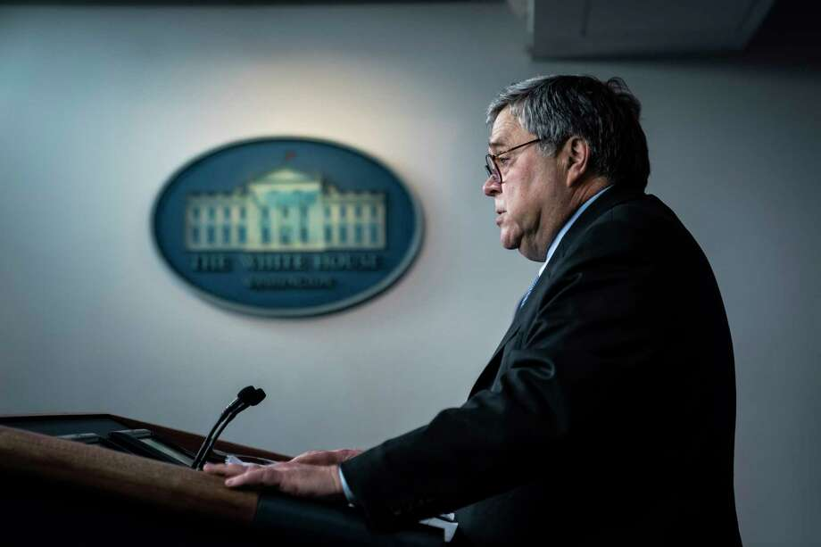 Attorney General William Barr speaks with President Trump and the coronavirus task force during a briefing last month. Photo: Washington Post Photo By Jabin Botsford. / The Washington Post