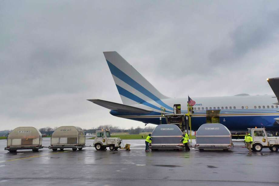 Crews unload one million surgical masks from a 767 plane that came in from China, at the Albany Airport Cargo Facility on Thursday, April 9, 2020, in Latham, N.Y. The aircraft is owned by Las Vegas Sands Chairman and CEO Sheldon Adelson. (Paul Buckowski/Times Union) Photo: Paul Buckowski, Albany Times Union / (Paul Buckowski/Times Union)